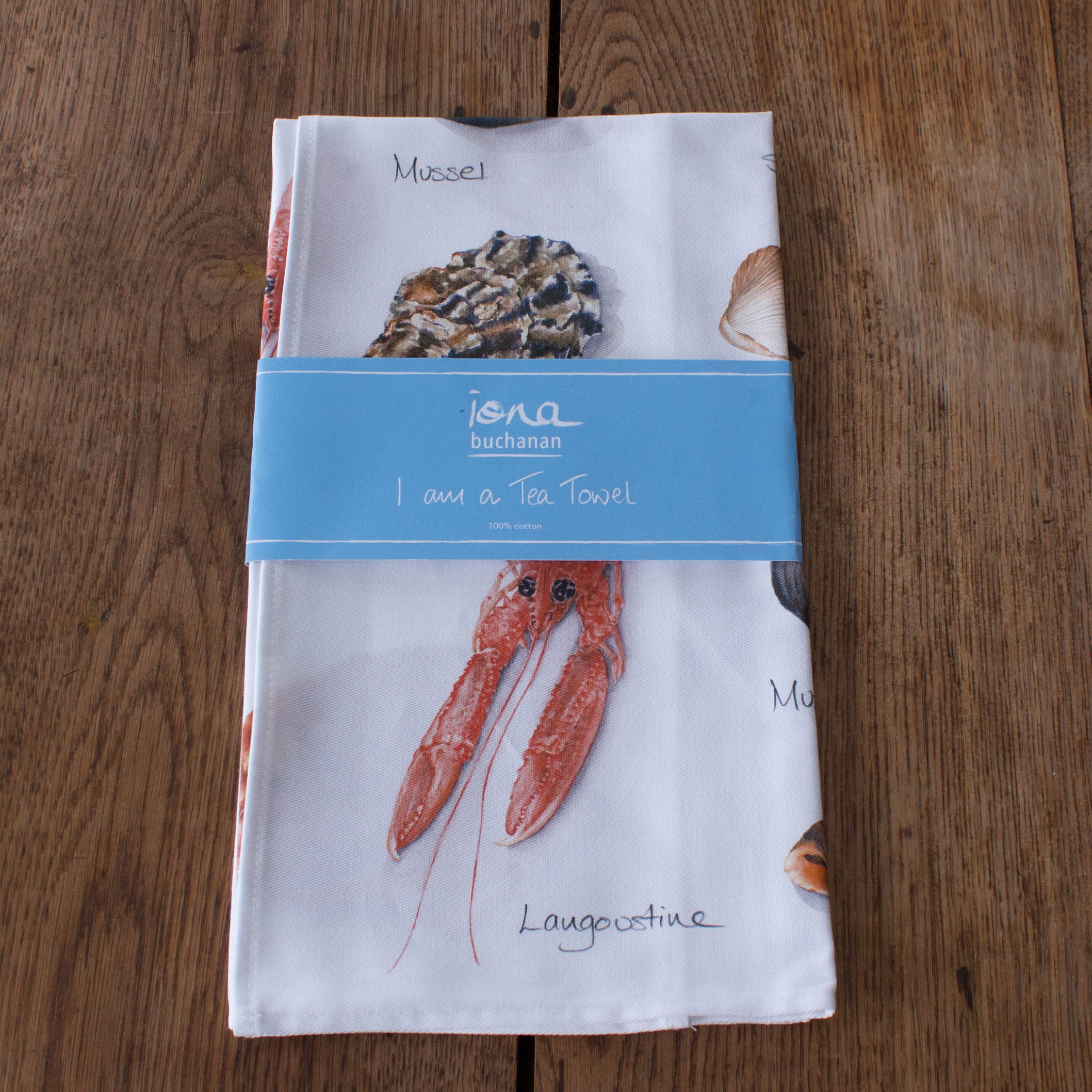 tea towel with shellfish, sea shell design in packaging
