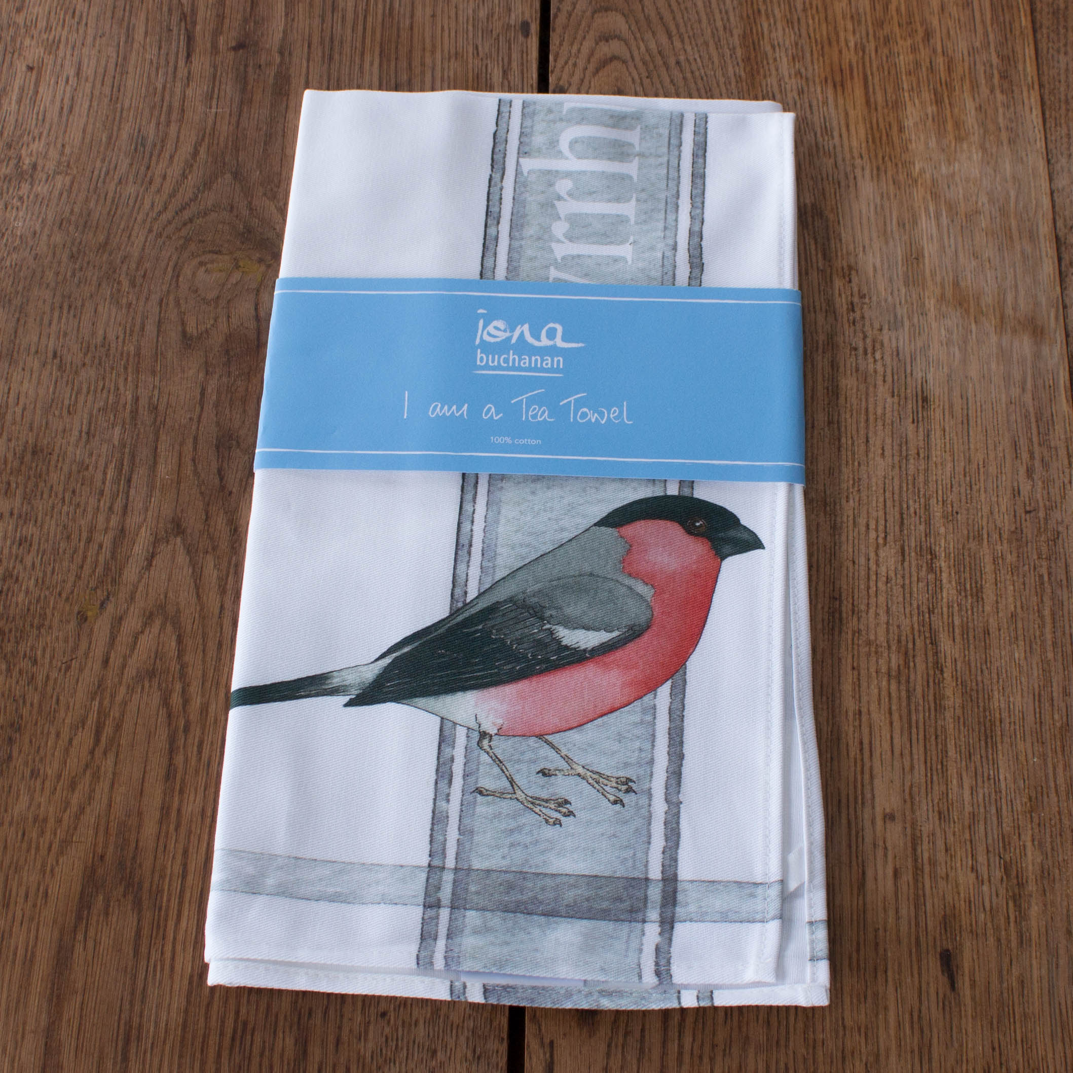 tea towel with bullfinch design in packaging