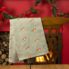A tea towel with a Robin & Mistletoe design
