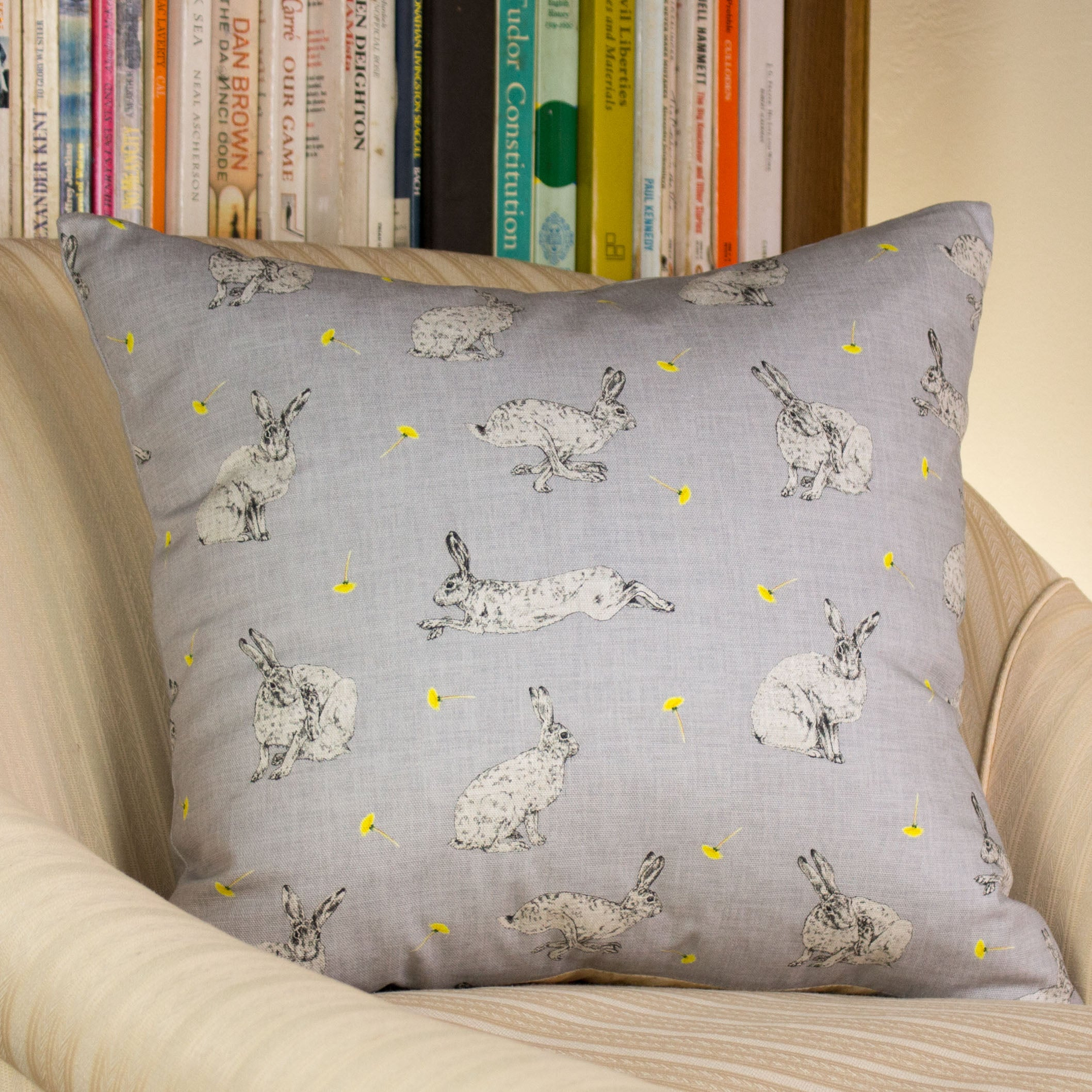 A cushion featuring a hare and dandelion design