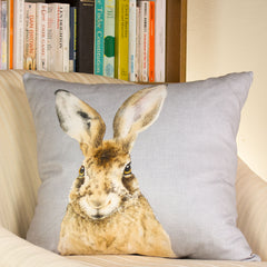 A cushion featuring a single hare looking out