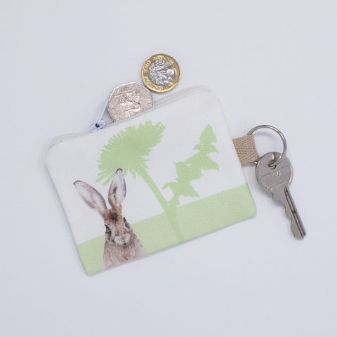 A key fob purse with a hare design