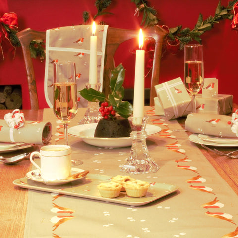 A robin and mistletoe table runner in a Christmas table setting