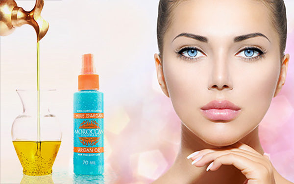 woman with beautiful skin using argan oil