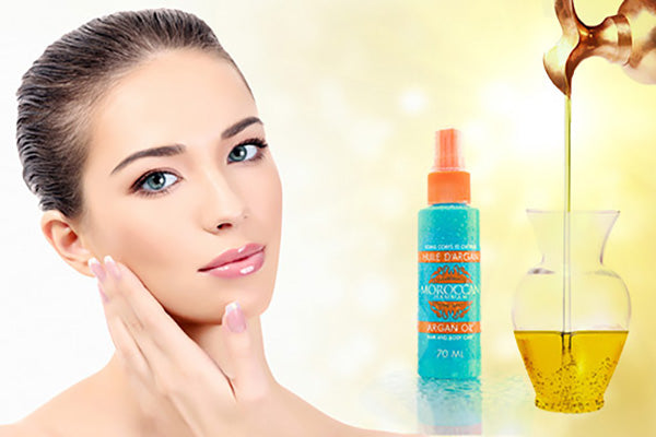 woman hydrating her skin with argan oil