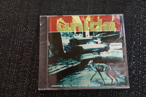 "Unida ""Coping with the Urban Coyote"" 1999 CD Art By Kozik"