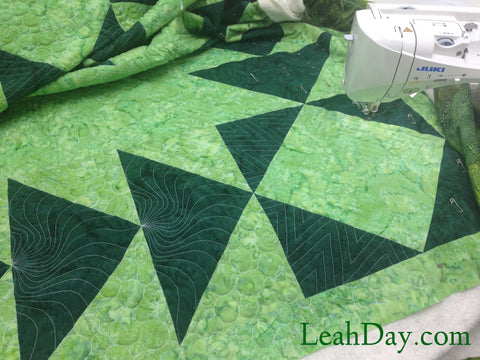 Quilting stencils used to mark and quilt king sized quilt by Leah Day