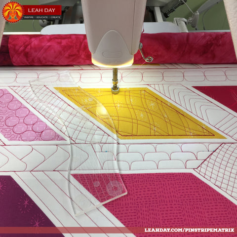 Loading a quilt on a longarm quilting frame