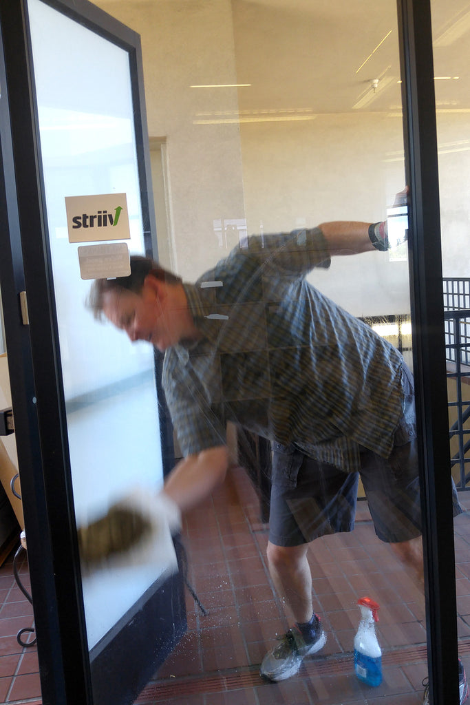 Doug Lawrence cleans the entryway windows.