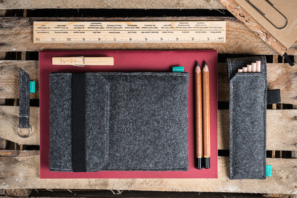 Dark gray iPad case with flap and elastic band together with felt pencil holder - designed and handmade by Gopher