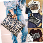 FAUX LEATHER ANIMAL PRINT CLUTCHES