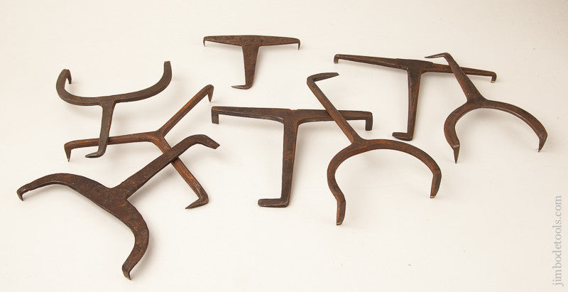 Collection of Eight Hand forged Bench Dogs