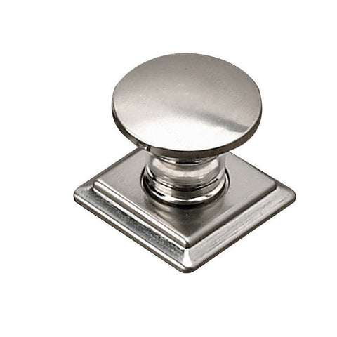 Contemporary kitchen cabinet knob in brushed nickel square and round.