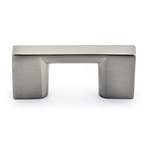 Modern kitchen cabinet knob with rectangular metal shape in brushed nickel.
