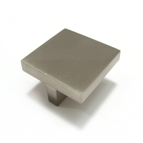 Modern kitchen cabinet knob with square metal shape in brushed nickel.