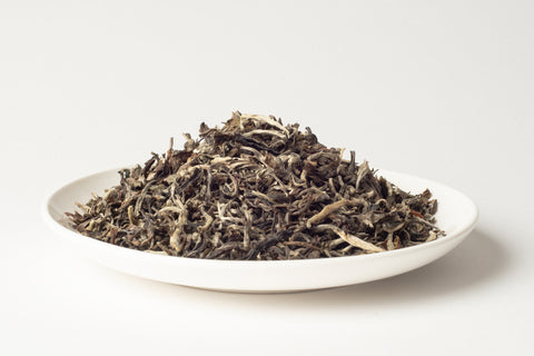 No.110 White Noise - A rare, hand-made white tea that is delicate, floral and silky smooth that draws an amber coloured brew.