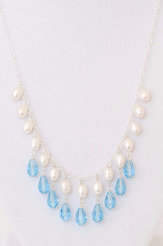 Blue teardrop crystals and white freshwater pearls bridal bib necklace by J'Adorn Designs custom jewelry