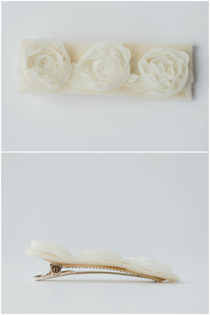 Couture flower girl hair clip appropriate for young girls toddler to tween. Ivory fabric rosettes over felt attached to silver plated clip. Made by hand by J'Adorn Designs, Baltimore Maryland couture and custom jewelry studio, photography by Nichole Rosado Meredith