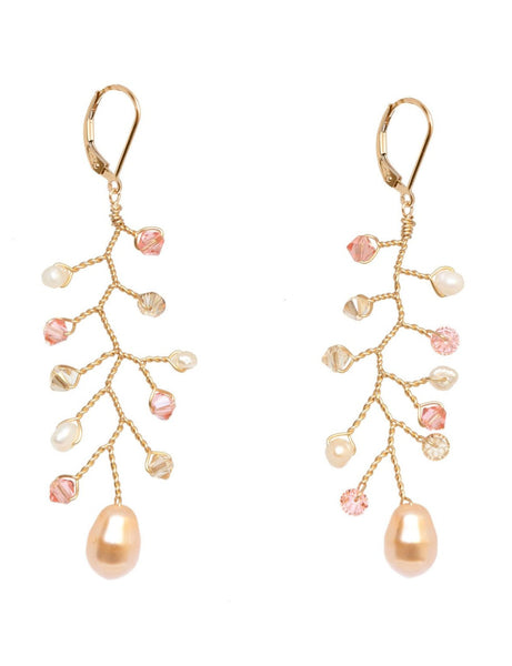 Delicate gold vine earrings in peach and blush crystals with freshwater pearl accents. Handcrafted bridal earrings for a bride or wedding party gifts, made by J'Adorn Designs artisan jewelry made in Baltimore, Maryland.