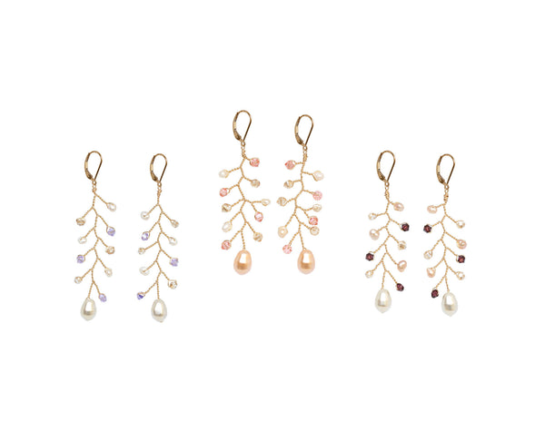 Three pairs of delicate vine earrings in various colors to match wedding colors with jewelry. Lightweight gold branch earrings in purple/ivory, blush/peach, and merlot/ivory color palettes. Handcrafted wedding jewelry by J'Adorn Designs artisan jewelry.