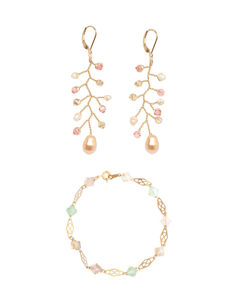 Peach and blush jewelry set featuring pretty crystal and pearl vine earrings and a delicate gold link bracelet with pastel rainbow colored crystals. Jewelry gift set for women, brides, and wedding party by J'Adorn Designs artisan jewelry.