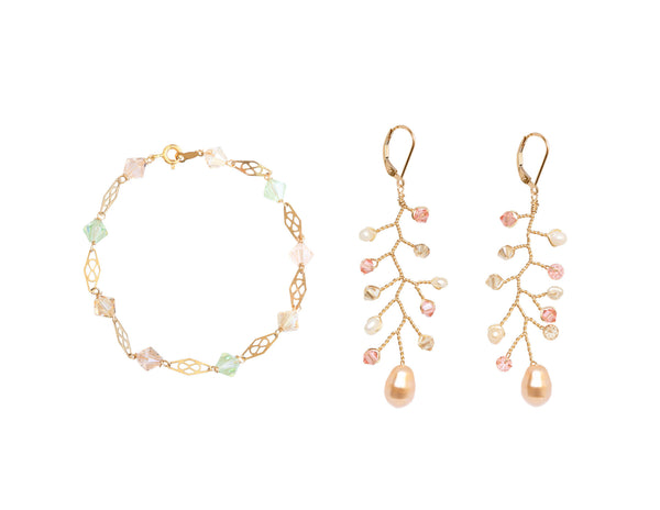One delicate gold & crystal link bracelet in light rainbow colors pairs perfectly with peach and blush earrings in the shape of a delicate vine. Handcrafted jewelry gift set by J'Adorn Designs artisan jewelry.