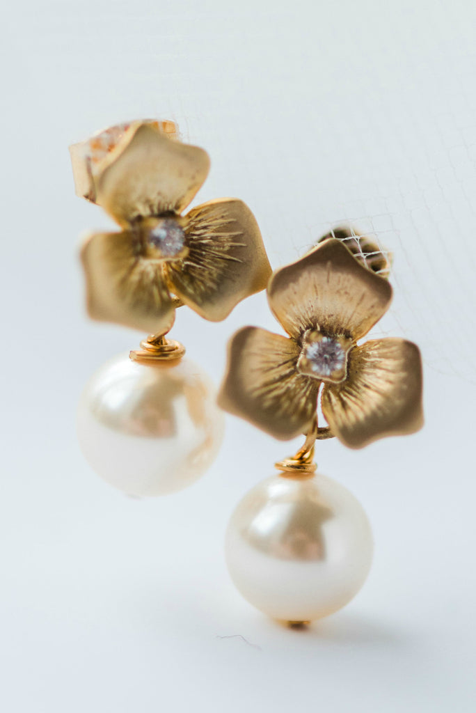 Tiny gold flower and pearl drop bridal earrings for wedding bride or bridesmaid jewelry gift by J'Adorn Designs, Baltimore Maryland couture and custom jewelry studio, photography by Nichole Rosado Meredith