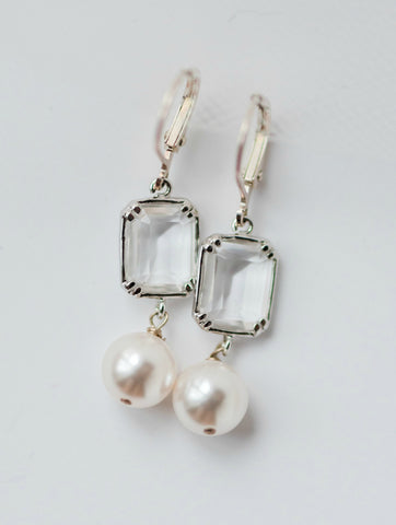 Couture handcrafted bridal or bridesmaid earrings w/ clear emerald cut Swarovski® crystal & white or ivory 10mm Swarovski® pearl. Sterling silver leverback earrings for sensitive ears, by J'Adorn Designs, Baltimore Maryland couture and custom jewelry studio, photography by Nichole Rosado Meredith