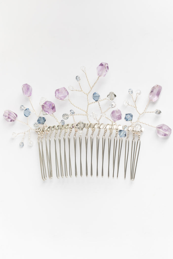 Amethyst and silver hair comb with blue and grey crystal branches. Colorful bridal headpiece in purple and cool colors, handcrafted hair accessories by J'Adorn Designs jewelry artisan Alison Jefferies.