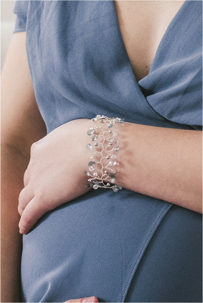 Maternity portrait featuring an intricate aquamarine and silver pearl vine bracelet. Handcrafted jewelry for luxury weddings and fashion by J'Adorn Designs artisan jeweler Alison Jefferies of Baltimore, Maryland.