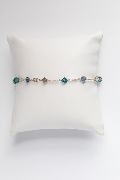 Teal, grey, and slate blue Swarovski crystal bracelet with delicate gold links, handcrafted bracelet by J'Adorn Designs custom jeweler