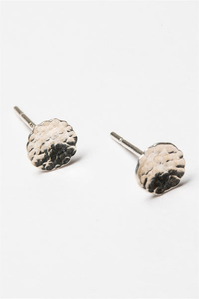 Small hammered sterling silver disc stud earrings. Artisan jewelry and luxury bridal accessories handmade in Maryland by Alison Jefferies of J'Adorn Designs.