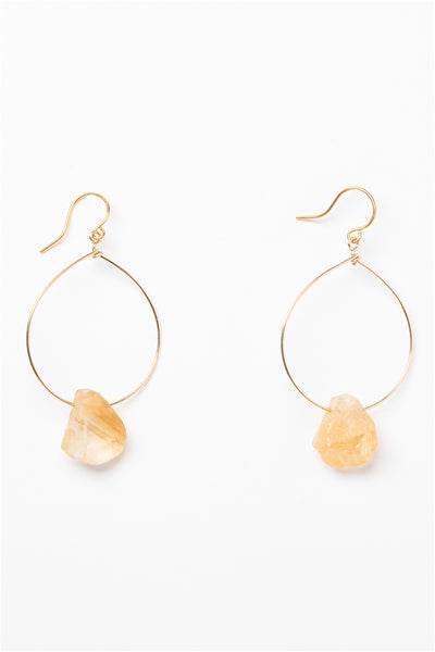 One pair of gold hoop earrings for sale with rough citrine teardrops. 14k gold filled modern hoop earrings for fashion or a jewelry gift idea. Artisan jewelry and luxury bridal accessories handmade in Maryland by Alison Jefferies of J'Adorn Designs.