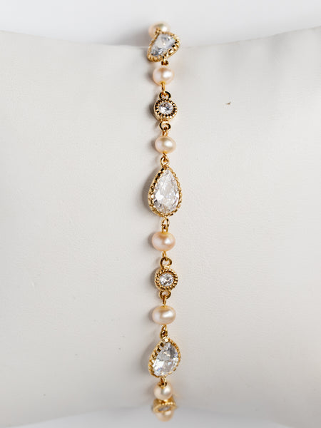Pear shaped bridal bracelet with golden pearls; gold bridal bracelet by J'Adorn Designs custom wedding jewelry and modern bridal accessories