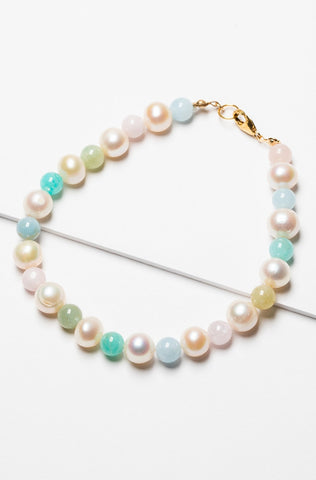 A beautiful rainbow inspired pearl bracelet made with freshwater pearls and multicolored beryl beads with a gold filled clasp. Artisan jewelry by J'Adorn Designs.