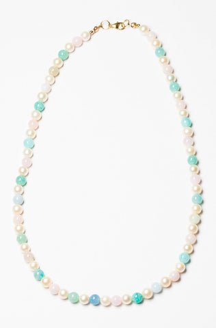 One handcrafted strung pearl necklace in rainbow pastel colors, made with white freshwater pearls and beryl beads with a 14k gold filled clasp. Artisan jewelry and luxury bridal accessories handmade in Maryland by Alison Jefferies of J'Adorn Designs.