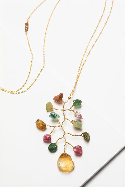 Long asymmetrical necklace with rough rainbow tourmaline and citrine gemstones in a wire wrapped branch design made by J'Adorn Designs artisan Alison Jefferies of Baltimore, MD.
