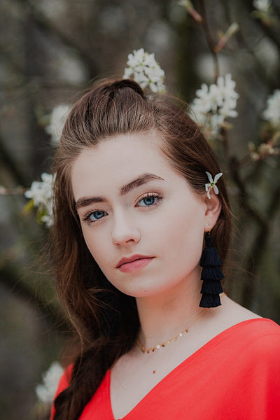 Tiered tassel earrings in black, handcrafted jewelry by J'Adorn Designs, modeled by a young woman for senior portraits by Maria Ortiz Photography