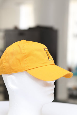 "The ""I"" of Iota polo dad cap, gold"