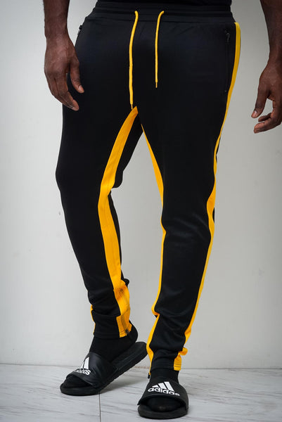 Run The Yard track pants, black/gold