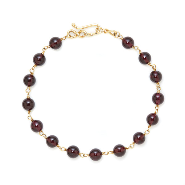 Red garnet bead 18k gold bracelet