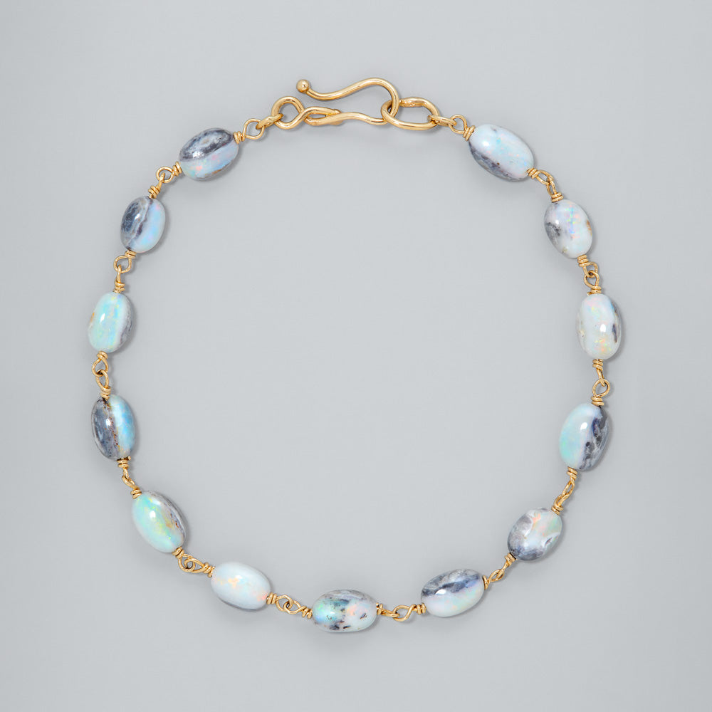 White opal 'firey' pebble 18k gold bracelet