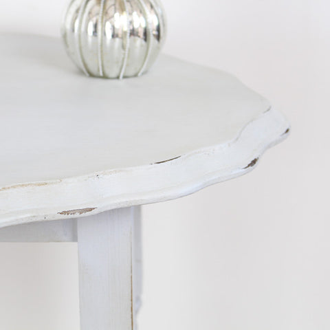 Close up of grey barley twist leg table