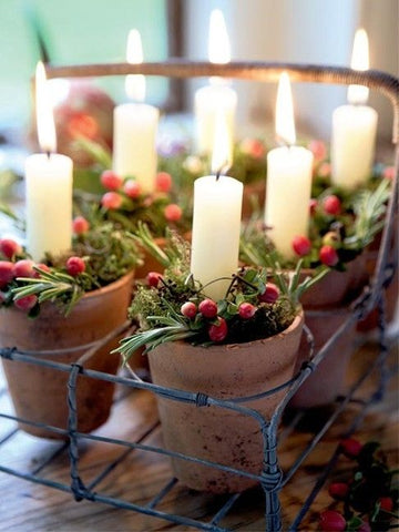 Red berries and candles at Christmas