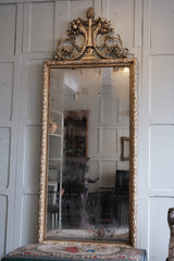A Large Neo Classical Carved & Gilt Mirror