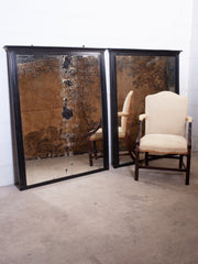 A Pair of Ebonised Mirrors