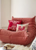 Kouamo - Trinidad Silk Cushion (Ruby Sun) on a Togo Ligne Roset Sofa