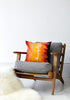 Kouamo - Exotic Vine Cotton Cushion (Sunset) photographed by Yeshen Vemena with Swoon Editions Chair