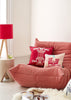 Kouamo - Juan y Pitin Pink Linen Cushion (Warm Welcome) photographed by Yeshen Venema on Ligne Roset Togo sofa