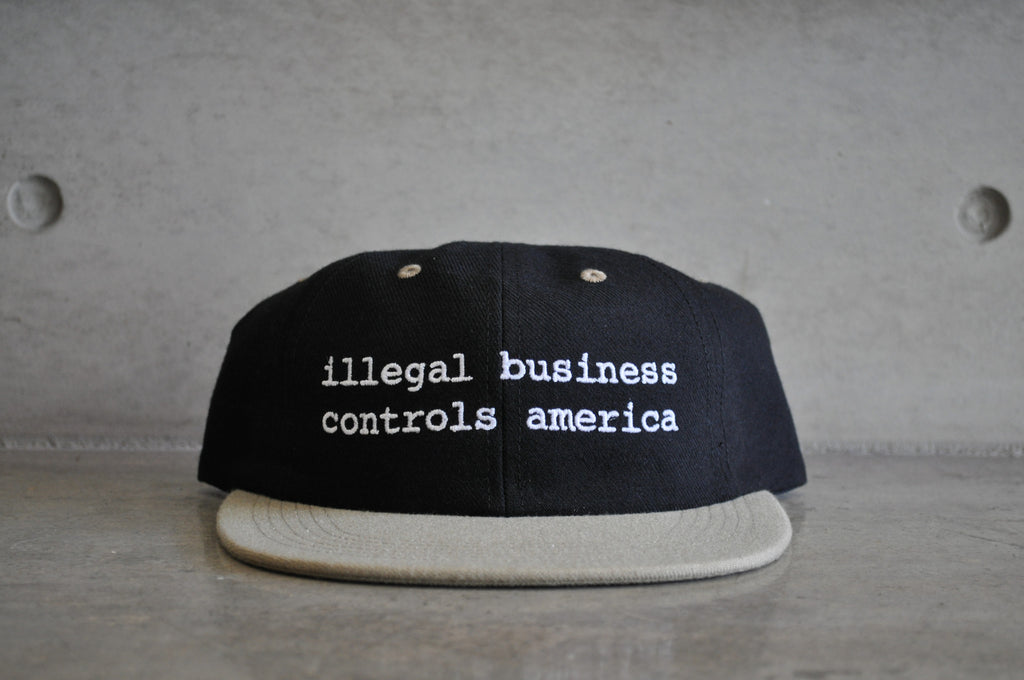 "Supreme ""Illegal Business Controls America"" Black Snapback Cap"